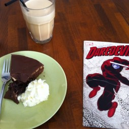 I enjoyed my Daredevil with an iced latte and chocolate cake