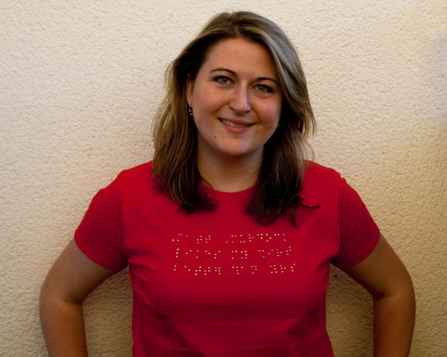 Photo of Christine in wearing a braille T-shirt