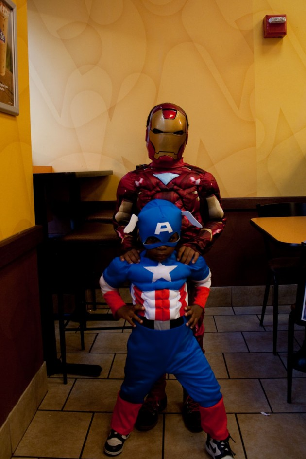 Photo of two kids dressed up as Cap and Iron Man at Dunkin' Donuts