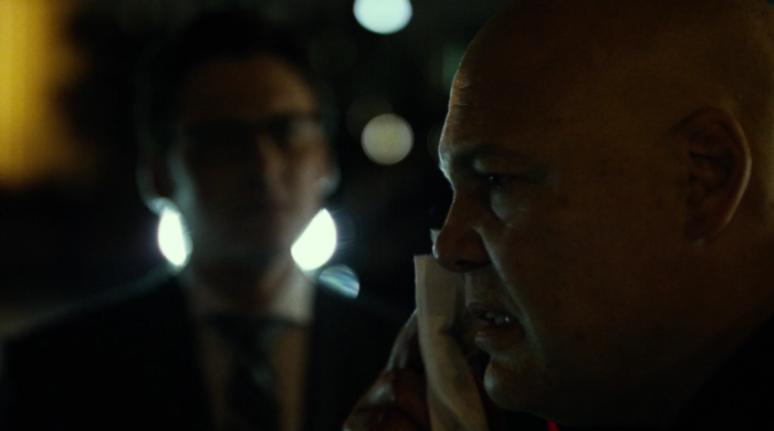 Fisk wipes his face after taking a man's head off with a car door, from episode four of Marvel's Daredevil