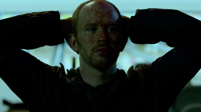 John Healy, who just killed a man with a bowling ball, kneels while waiting for the police, as seen in episode three of Marvel's Daredevil