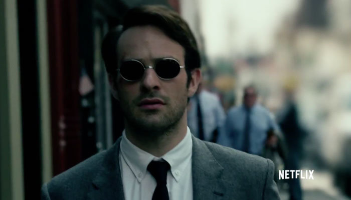 Matt Murdock walking down the street, from Marvel's Daredevil on Netflix