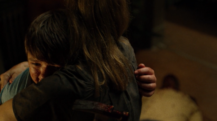 Young Wilson Fisk hugs hit mother after killing his father, as seen in episode eight of Marvel's Daredevil on Netflix