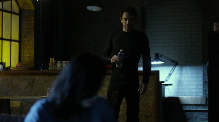Claire helps Matt check what's in the phone he found on the crooked cop, as seen in Marvel's Daredevil on Netflix, episode five