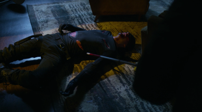 Foggy finds Matt, in his mask, collapsed on the floor of his apartment, as seen in Marvel's Daredevil on Netflix