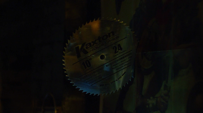 Melvin throws a saw blade that says Kaxton Industries on it, as seen in episode eleven of Marvel's Daredevil on Netflix