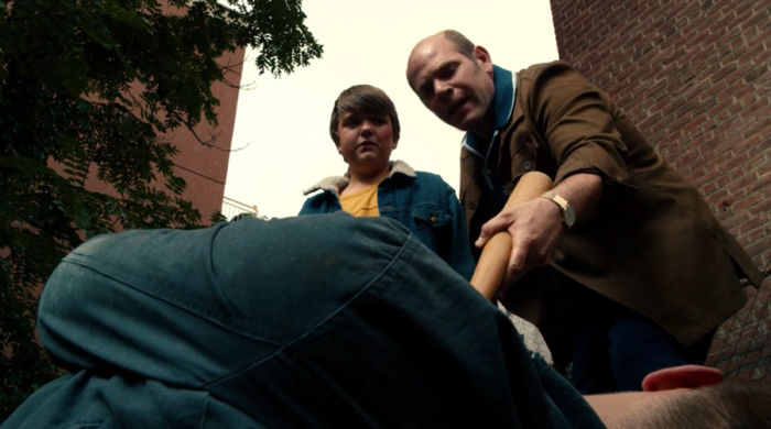 Bill Fisk coerces young Wilson to kick a local bully, as seen in episode eight of Marvel's Daredevil on Netflix