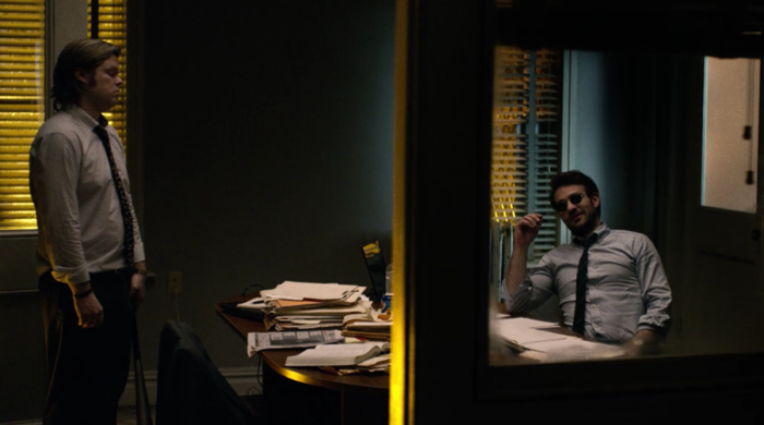 Matt and Foggy are talking in the office, as seen in episode seven of Marvel's Daredevil on Netflix