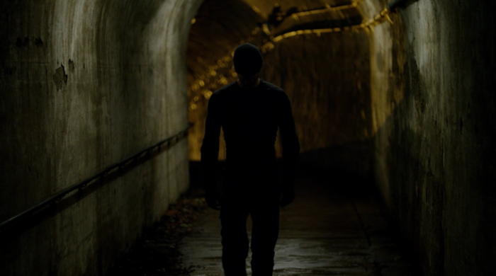 Matt walks out of the tunnel system at the end of episode six of Marvel's Daredevil on Netflix