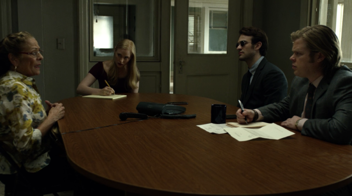 Mrs. Cardenas talks about her landlord Tully in the Nelson & Murdock conference room., from episode five of Marvel's Daredevil on Netflix