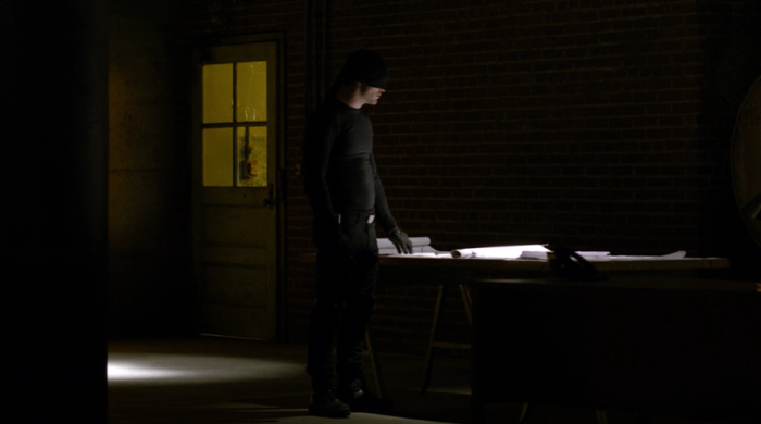 Matt examines the building plans with his hand, from episode nine of Marvel's Daredevil on Netflix