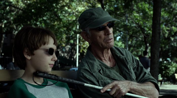Young Matt and Stick sit on a bench in the park, as seen in episode seven of Marvel's Daredevil on Netflix