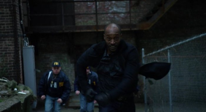 Turk running from the police, as seen in episode thirteen of Marvel's Daredevil on Netflix