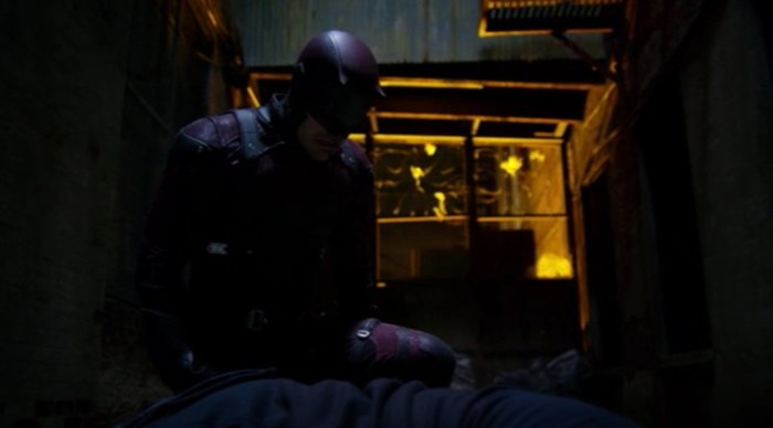 Daredevil kneeling over Fisk's unconscious body, as seen in episode thirteen of Marvel's Daredevil on Netflix