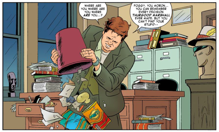 Mike Murdock's hat and glasses appear in the background, as seen in Daredevil #2 (vol 3), by Mark Waid and Paolo Rivera