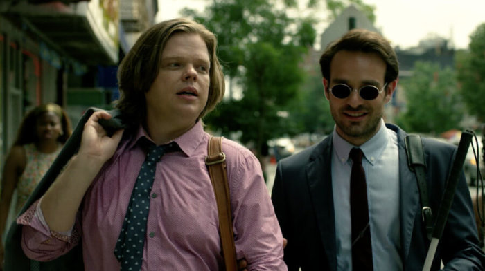 "Matt and Foggy are told to ""Watch it, asshole!"" by a woman Foggy bumps into, as seen in the first episode of season two of Daredevil on Netflix"
