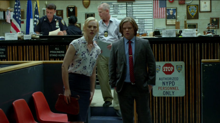 Karen and Foggy at the precinct, with photo of Stan Lee in the background, as seen in episode two of Daredevil, season two