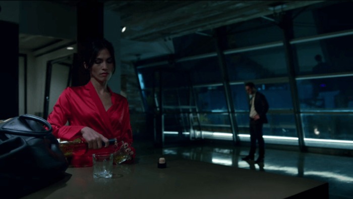 Elektra pours herself a drink when Matt comes by, as seen in episode five of Daredevil, season two