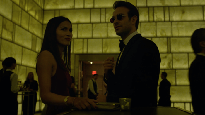 Matt and Elektra go to a party in search of a secret ledger, as seen in episode six of Daredevil, season two