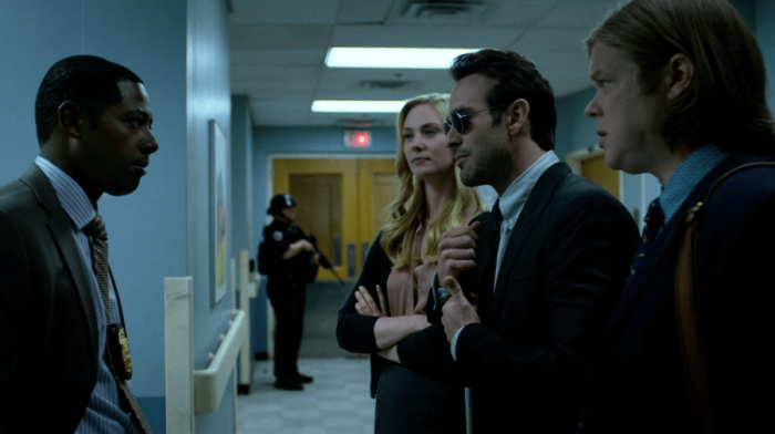 Matt, Foggy and Karen talk with Brett outside Frank Castle's hospital room, as seen in episode six of Daredevil, season two