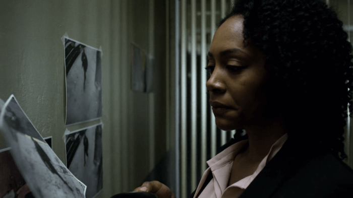 Misty Knight looking at evidence, as seen in Marvel's Luke Cage