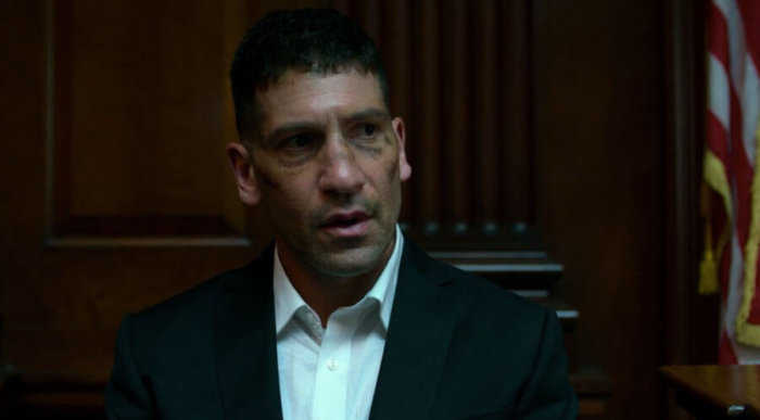 Frank trades glances with the bailiff, as seen in episode eight of Marvel's Daredevil, season two.