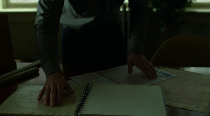 Matt examines a tactile subway map, as seen in episode 12 of Marvel's Daredevil, season two.