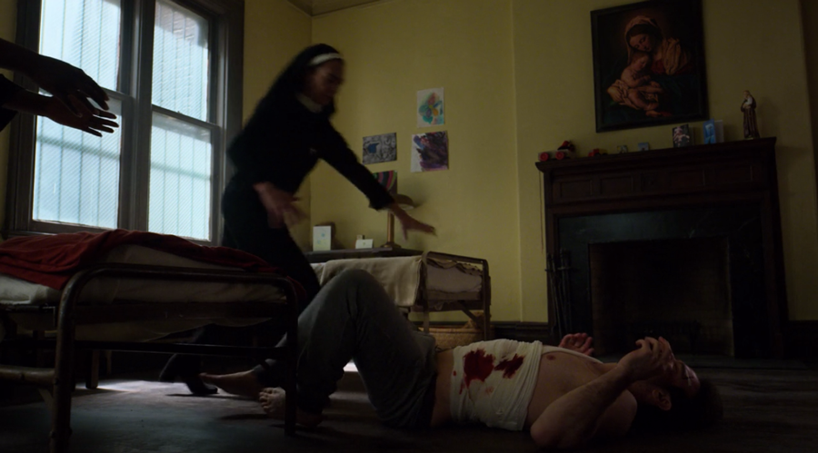 Matt falls out of bed as he's trying to stand, as seen on Marvel's Daredevil season three, episode one.