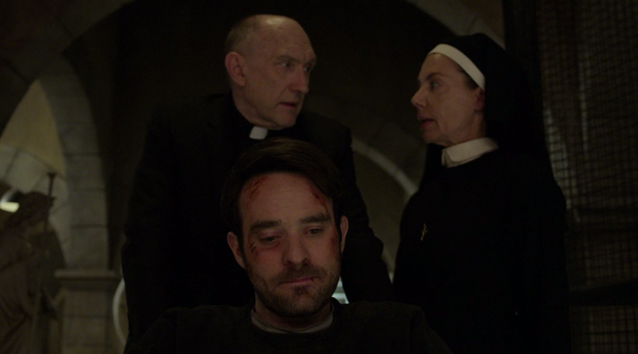Matt being wheeled into his new living quarters by Father Lantom and Sister Maggie, as seen on Marvel's Daredevil season three, episode one.