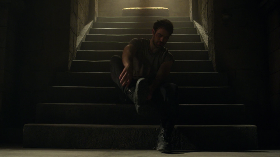 Matt puts on boots and gets ready to work out, as seen on Marvel's Daredevil season three, episode one.