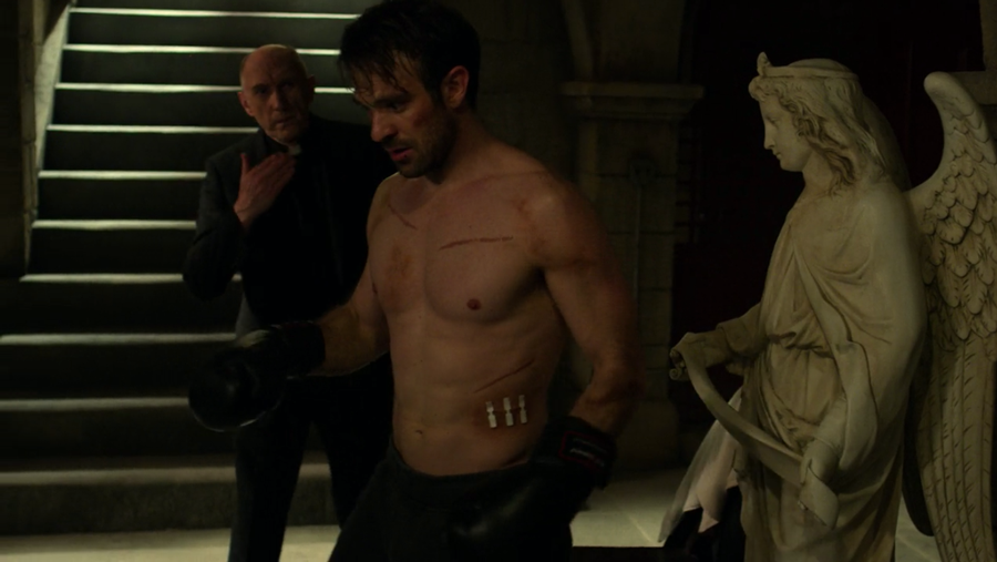 Matt struggling to get back into the fight after his sparring partner has knocked out his bad ear, as seen on Marvel's Daredevil season three, episode one.