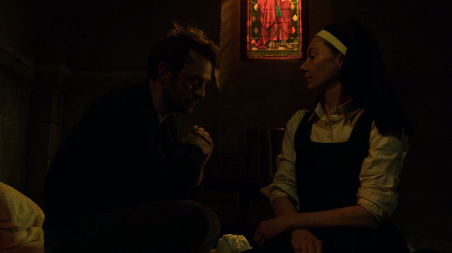 Matt sits on his bed pondering defeat when he is joined by Sister Maggie, as seen on Marvel's Daredevil season three, episode one.