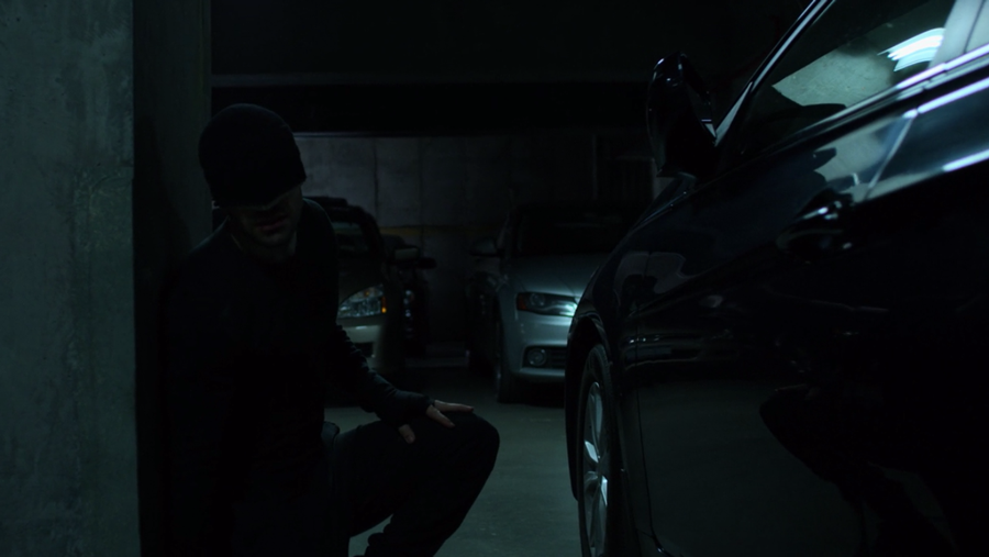 Matt hides behing another car, as seen in Marvel's Daredevil, season three episode three