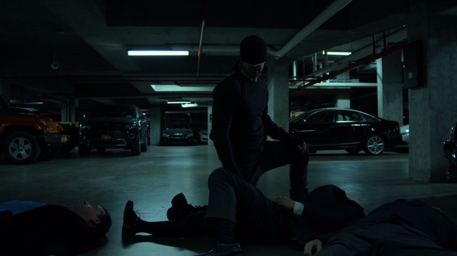 Matt crouches after knocking out several federal agents, as seen in Marvel's Daredevil, season three episode three