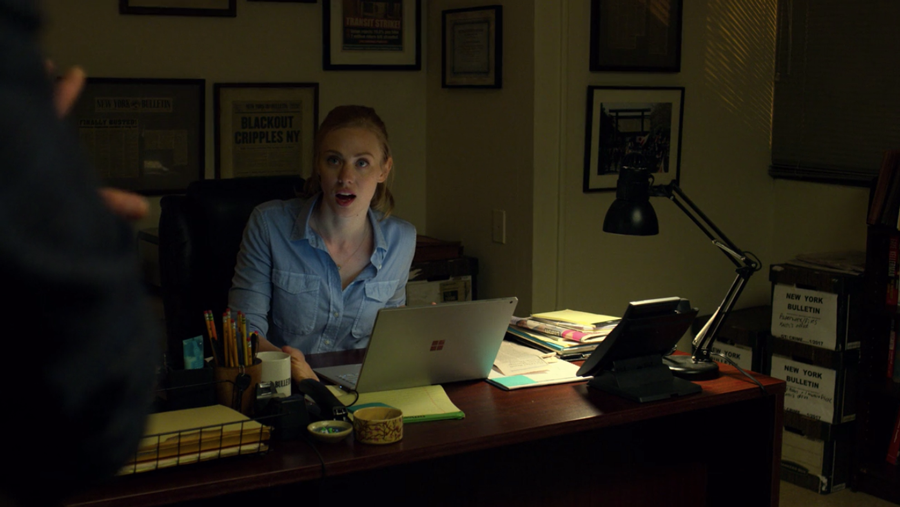 Karen, at work, defending going to Fisk's hotel, as seen in Marvel's Daredevil, season three episode three