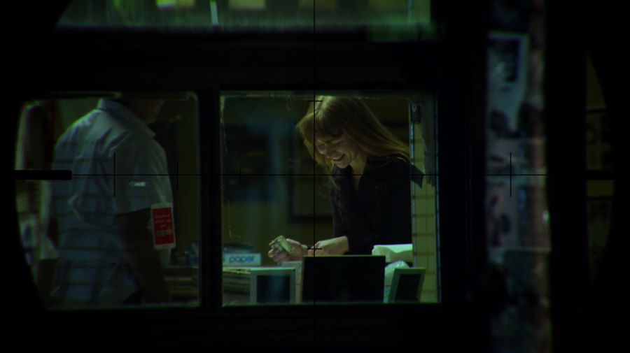 Through the crosshairs of Dex's monocular, we see Julie getting pizza, as seen in Marvel's Daredevil, season three episode three