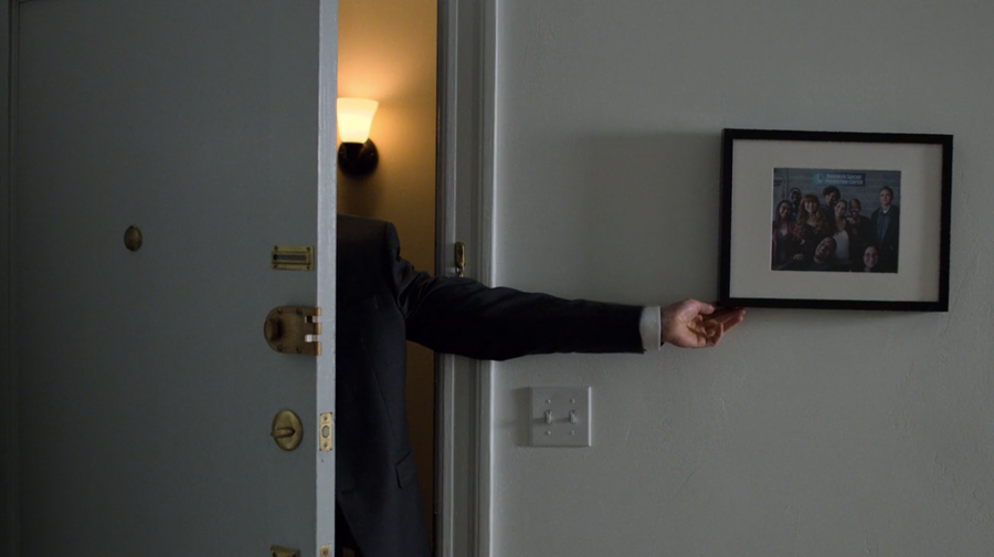 Dex corrects a misaligned photograph, as seen on Marvel's Daredevil season 3, episode 5