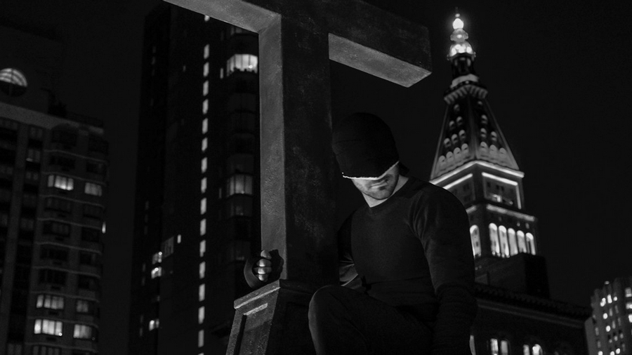 Renew Daredevil promotional feature showing Matt, as the Man in Black, sitting atop the Clinton Church